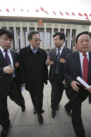 Communist Party Secretary of Inner Mongolia Autonomous Region Hu Chunhua (2nd L) walks with other delegates after a session of the National People's Congress (NPC) outside the Great Hall of the People in Beijing, March 10, 2009. REUTERS/Stringer/Files