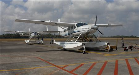 Seaplanes park at the Ngurah Rai airport in Bali September 19, 2012. The seaplane taxiing over a coral reef to deliver tourists to a remote luxury resort may soon become a more familiar sight in Indonesia, an archipelago of 17,000 islands and only 183 airports. At the moment, seaplanes in Indonesia are limited to niche charter flights for high-end tourism and mining, but their use could spread to serve the needs of a fast-growing economy and to beat the lack of transport infrastructure. Picture taken September 19, 2012. REUTERS/Neil Chatterjee