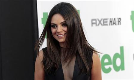 Cast member Mila Kunis poses at the premiere of ''Ted'' at the Grauman's Chinese theatre in Hollywood, California June 21, 2012. The movie opens in the U.S. on June 29. REUTERS/Mario Anzuoni