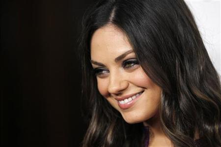 Actress Mila Kunis poses at the benefit gala for the 50th anniversary of St. Jude Children's Research Hospital in Beverly Hills, California, January 7, 2012. REUTERS/Danny Moloshok/Files
