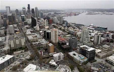 Downtown Seattle and the Elliott Bay waterfront are seen from atop the roof of the 650-foot-tall Space Needle looking South over the skyline on April 17, 2012. REUTERS/Anthony Bolante
