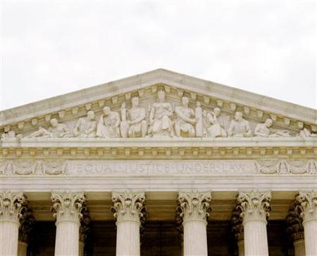 The front of the U.S. Supreme Court which reads 'Equal Justice Under Law' is seen in Washington July 19, 2005. UNICS REUTERS/Larry Downing