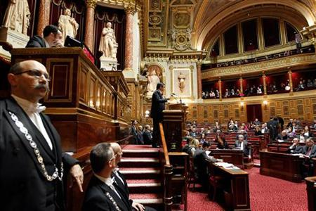 French Prime Minister Francois Fillon (C) delivers a speech during a debate about the right to vote in local elections for foreigners at the French Senate in Paris December 8, 2011. REUTERS/Charles Platiau