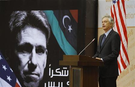 Visiting U.S. Deputy Secretary of State William Burns speaks in front of a picture of slain U.S. ambassador to Libya Christopher Stevens during a ceremony commemorating Stevens in Tripoli September 20, 2012. REUTERS/Anis Mili