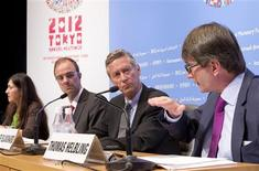 International Monetary Fund's Economic Counsellor and Director of Research Department Olivier Blanchard (2nd R), Deputy Director Jorg Decressin (2nd L), Division Chief Thomas Heibling (R) and Senior Press Officer Gita Bhatt hold a news briefing on the World Economic Outlook (WEO), at the Tokyo International Forum in Tokyo October 9, 2012. The IMF said the global economic slowdown is worsening as it cut its growth forecasts for the second time since April and warned U.S. and European policymakers that failure to fix their economic ills would prolong the slump. REUTERS/International Monetary Fund/Stephen Jaffe/Handout