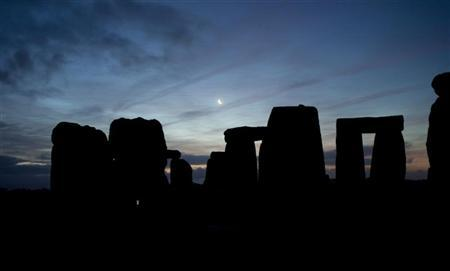 The moon rises above Stonehenge on Salisbury plain in southern England December 22, 2011. The winter solstice is the shortest day of the year, and the longest night of the year. REUTERS/Kieran Doherty
