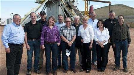 Minneapolis Federal Reserve Bank President Narayana Kocherlakota (far R) poses with board members at a drilling site near Stanley, North Dakota, August 16, 2012 in this handout photo supplied by Minneapolis Federal Reserve Bank. REUTERS/Kevin Cederstrom/Minneapolis Federal Reserve Bank/Handout