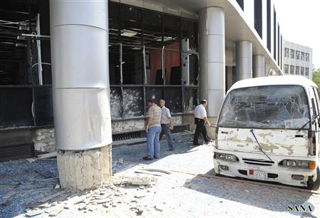 A view shows the wreckage of a bus after a bomb exploded at al-Zablatani area, in Damascus October 9, 2012, in this handout photograph released by Syria's national news agency SANA. REUTERS/Sana/Handout