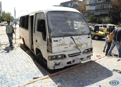 A view shows the wreckage of a bus after a bomb exploded at al- Zablatani area, in Damascus October 9,2012, in this handout photograph released by Syria's national news agency SANA. REUTERS/Sana/Handout