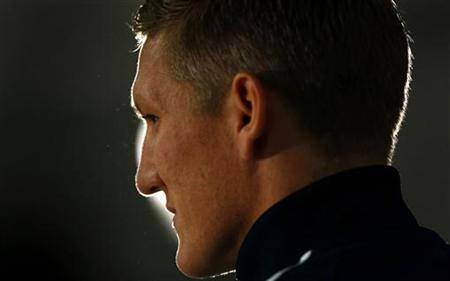 Germany's national midfielder Bastian Schweinsteiger addresses a news conference after a practice session in Frankfurt, October 9, 2012. REUTERS/Kai Pfaffenbach