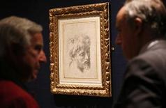 "Visitors look at Raphael's ""Auxiliary cartoon for the Head of a Young Apostle from 1519-1520 which has an estimated value of £10 to £15 million (US$16 - $24 million) at Sotheby's London October 8, 2012. REUTERS/Suzanne Plunkett"