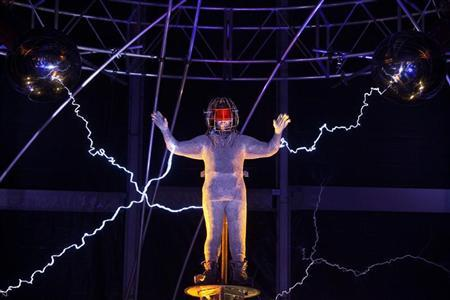 Magician David Blaine channels bolts of electricity from various tesla coils charged with one million volts of electricity during a stunt on Pier 54 in New York, October 5, 2012. REUTERS/Andrew Burton