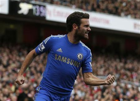 Chelsea's Juan Mata celebrates after Arsenal's Laurent Koscielny (not pictured) scored an own goal from his free kick during their English Premier League soccer match at the Emirates Stadium in London September 29, 2012. REUTERS/Eddie Keogh