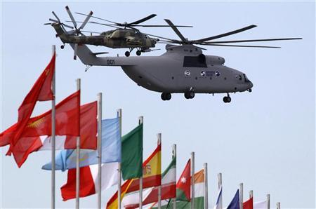 Mi-26 (bottom) and Mi-28 helicopters perform during the MAKS International Aviation and Space Salon in Zhukovsky, outside Moscow, August 19, 2011. REUTERS/Sergei Karpukhin