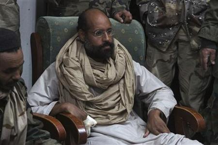 Saif al-Islam is seen after his capture, in the custody of revolutionary fighters in Obari, Libya November 19, 2011. REUTERS/Ammar El-Darwish