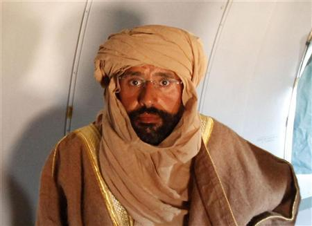 Saif al-Islam Gaddafi is seen sitting in a plane in Zintan November 19, 2011. Saif al-Islam Gaddafi told Reuters on Saturday that he was feeling fine after being captured by some of the fighters who overthrew his father and he said injuries to his right hand were suffered during a NATO air strike a month ago. REUTERS/Ismail Zitouny