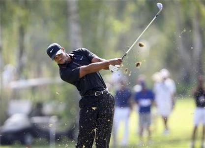 Tiger Woods of U.S. tees off on the 7th hole during his PGA World Golf Final Group 1 match against Charl Schwartzel of South Africa in Antalya, southern Turkey, October 9, 2012. REUTERS/Umit Bektas