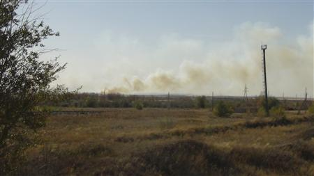 Smoke rises above the area near a military testing ground outside the Russian city of Orenburg October 9, 2012. REUTERS/AiF-Orenburg/Handout