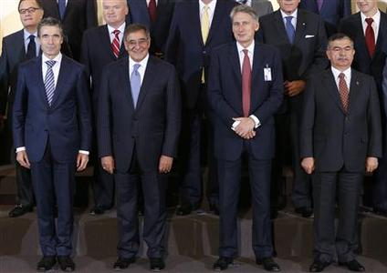 (front, L-R) NATO Secretary General Anders Fogh Rasmussen, U.S. Secretary of Defense Leon Panetta, Britain's Defence Secretary Philip Hammond and Turkey's Defence Minister Ismet Yilmaz pose for a family photo during a NATO defence ministers meeting at the Alliance headquarters in Brussels October 9, 2012. REUTERS/Francois Lenoir