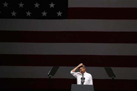 U.S. President Barack Obama gestures while speaking at an Obama Victory Fund concert while at the Bill Graham Civic Auditorium in San Francisco October 8, 2012. REUTERS/Larry Downing