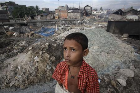 A boy stands in front of the tannery wastes at Hazaribagh in Dhaka October 9, 2012. REUTERS-Andrew Biraj