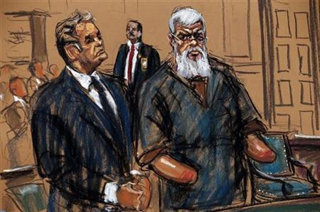 Islamist cleric Abu Hamza al-Masri is seen in this courtroom sketch standing with his lawyer Jeremy Schneider where he pleaded not guilty to criminal charges in U.S. District Court in Manhattan, October 9, 2012, after he was extradited from the U.K. last week to face terrorism charges in the U.S. REUTERS/Jane Rosenberg