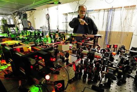 U.S. physicist David Wineland talks about is experiment in his lab during a media tour after a news conference in Boulder, Colorado, after learning he and Serge Haroche of France were awarded the 2012 Nobel Prize in Physics, October 9, 2012. The two men were awarded the prize for finding ways to measure quantum particles without destroying them, which could make it possible to build a new kind of computer far more powerful than any seen before. REUTERS/Mark Leffingwell