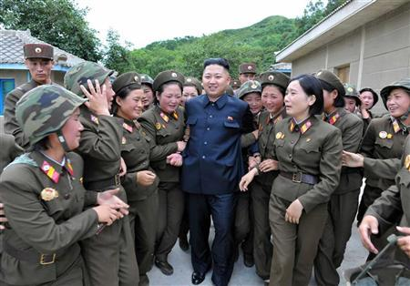 North Korean leader Kim Jong-un (C) visits the Thrice Three-Revolution Red Flag Kamnamu (persimmon tree) Company under the Korean People's Army Unit 4302 in this undated picture released by the North's official KCNA news agency in Pyongyang on August 24, 2012. REUTERS/KCNA