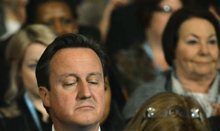 Britain's Prime Minister David Cameron listens during the keynote speech from London Mayor Boris Johnson, at the Conservative Party conference in Birmingham, central England October 9, 2012. REUTERS/Toby Melville