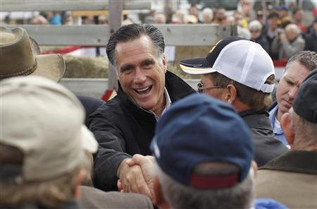Republican presidential nominee Mitt Romney shakes hands with supporters after a campaign rally at the James Koch Farm in Van Meter, Iowa October 9, 2012. REUTERS/Shannon Stapleton