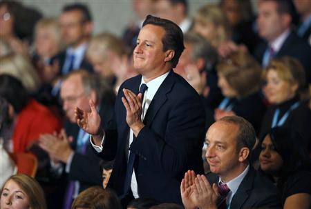 Britain's Prime Minister David Cameron stands as he applauds the keynote speech from London Mayor Boris Johnson, at the Conservative Party conference in Birmingham, central England October 9, 2012. REUTERS/Darren Staples