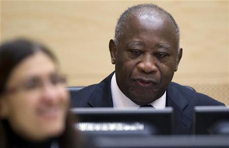Ivory Coast's former president Laurent Gbagbo waits for the judges to arrive for his initial court appearance at the International Criminal Court in The Hague December 5, 2011. REUTERS/Peter Dejong/Pool