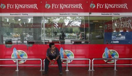 An airlines staff member sits in front of a closed Kingfisher Airlines ticketing counter at the airport in Kolkata October 3, 2012. REUTERS/Rupak De Chowdhuri
