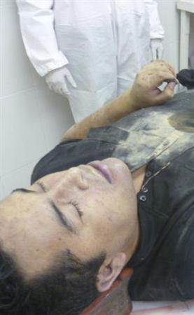 The body of Heriberto ''The Executioner'' Lazcano is seen lying on a table after he was killed in a shootout with Marines in a gun battle in northern Mexico, in this photograph taken early October 8, 2012 and distributed by the Mexican Navy and received by Reuters October 9, 2012. REUTERS/Semar/Handout