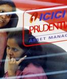 An employee of the life insurance company ICICI Prudential speaks on a phone in the company's office, in Mumbai June 19, 2007. REUTERS/Arko Datta