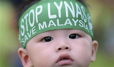 A child wears a headband during a protest against the construction of Australia's Lynas Corp earths plant in Gebeng, 270 km (168 miles) east of Kuala Lumpur June 24, 2012. REUTERS/Stringer