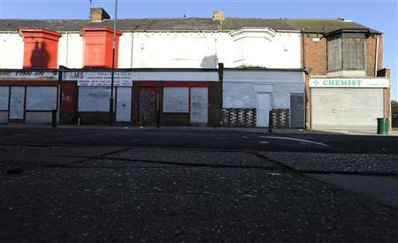 Boarded up shops are seen in Grangetown near Middlesbrough, northern England November 6, 2011. REUTERS/Nigel Roddis