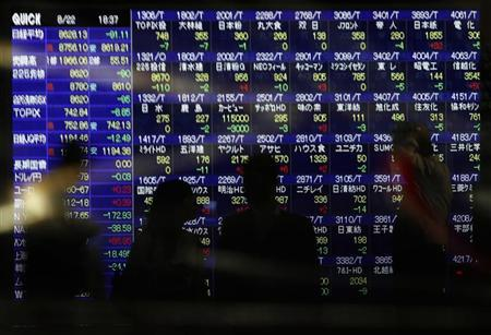 People, standing in front of an electronic board displaying share prices, wait to cross a street as cars pass by in Tokyo August 22, 2011. REUTERS/Yuriko Nakao/Files