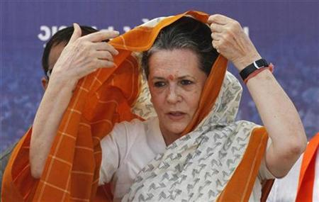 Sonia Gandhi adjusts her saree during an election campaign rally ahead of state assembly elections at Rajkot, in Gujarat October 3, 2012. REUTERS/Amit Dave