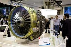 <p>Stand Safran au salon du Bourget. Le fonds activiste britannique The Children's Investment Fund (TCI) a lancé une offensive contre la politique d'acquisitions menée récemment par le groupe français hors du secteur de l'aérospatiale civile. /Photo d'archives/REUTERS/Benoît Tessier</p>