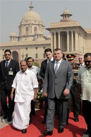 Russian Defence Minister Anatoly Serdyukov (4th R) along with his Indian counterpart A. K. Antony (in white) walk for their meeting in New Delhi October 10, 2012. REUTERS/B Mathur