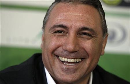 Hristo Stoichkov smiles during a news conference in Lovech, some 140 km (87 miles) north-east of Sofia January 5, 2012. REUTERS/Stoyan Nenov