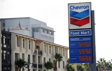 Gas prices are displayed at a Chevron gas station in Los Angeles, California October 9, 2012. The unprecedented price spike that added more than 50 cents a gallon to California pump prices last week ended as quickly as it began, market analysts said, and consumers should see prices fall dramatically in the coming week. REUTERS/Mario Anzuoni
