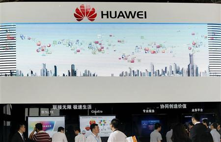 People visit the Huawei booth at a communication technologies exhibition in Beijing, September 19, 2012. China's telecom companies ZTE and Huawei have denied allegations that their products could threaten U.S. state security, accusing them of obstructing Chinese ICT companies from entering the overseas market, Xinhua News Agency reported. Picture taken September 19, 2012. REUTERS/China Daily