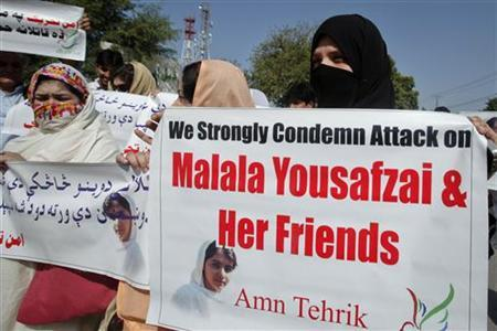 Female supporters of a Amin Tehrik (peace movement) hold signs during a rally to condemn the attack on schoolgirl Malala Yousufzai in Peshawar October 10, 2012. REUTERS/Fayaz Aziz