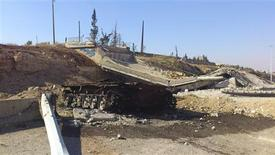 A destroyed tank of Syrian President Bashar al Assad's forces is seen after clashes with the Free Syrian Army in the Rasten area, near Homs September 26, 2012. Picture taken September 26, 2012. REUTERS/Shaam News Network/Handout