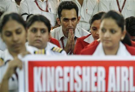 Employees of Kingfisher Airlines take part in a protest against the company in New Delhi October 9, 2012. REUTERS/Stringer