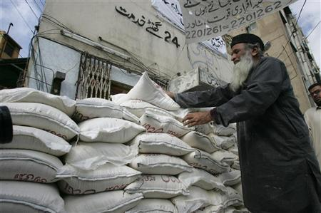 Renowned Pakistan social worker Abdul Sattar Edhi arranges relief supplies for the flood surviviors in Karachi. Renowned Pakistan social worker Abdul Sattar Edhi arranges relief supplies in Karachi for the flood surviviors of the southern Baluchistan province, Pakistan February 14, 2005. REUTERS/Zahid Hussein