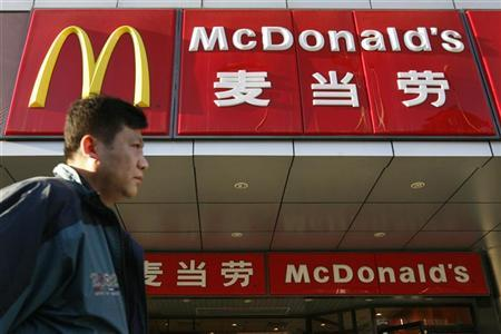 A man walks past a McDonald's outlet in Beijing April 2, 2007. REUTERS/Claro Cortes IV