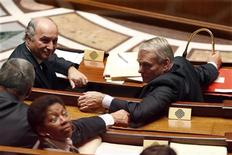 French Prime Minister Jean-Marc Ayrault (R) and Foreign Affairs Minister Laurent Fabius (L) attend a debate before the vote of the a law ratifying a European budget discipline treaty at the National Assembly in Paris October 9, 2012. REUTERS/Charles Platiau